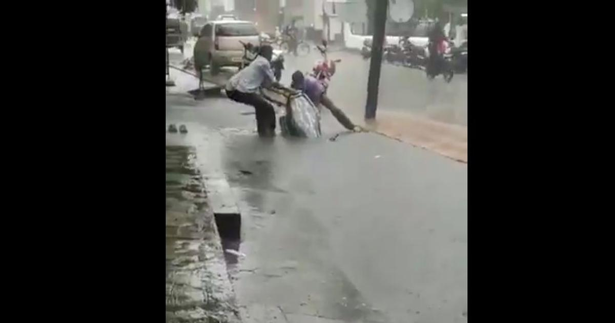 Video of people pulling two-wheeler out of manhole goes viral, Twitter furious